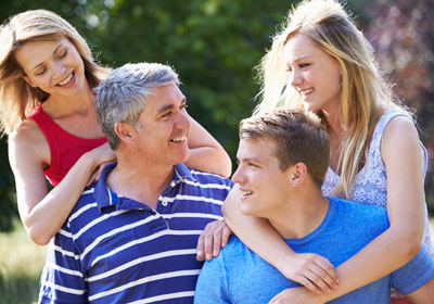 goodencenter-mental-health-treatment-photo-of-Happy-young-family-of-Family-With-Teenage-Children-Walking-In-Countryside