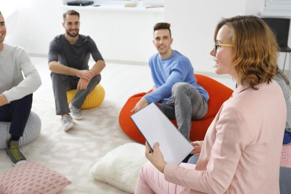 goodcenter-OCD-and-the-Drive-for-Success---Is-Residential-Treatment-the-Answer-photo-of-Female-psychologist-and-patients-at-group-psychotherapy-session-indoors