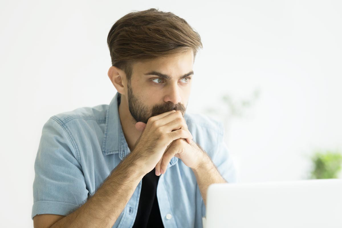 goodcenter-OCD-and-the-Drive-for-Success---Is-Residential-Treatment-the-Answer-photo-of-Thoughtful-serious-young-man-lost-in-thoughts