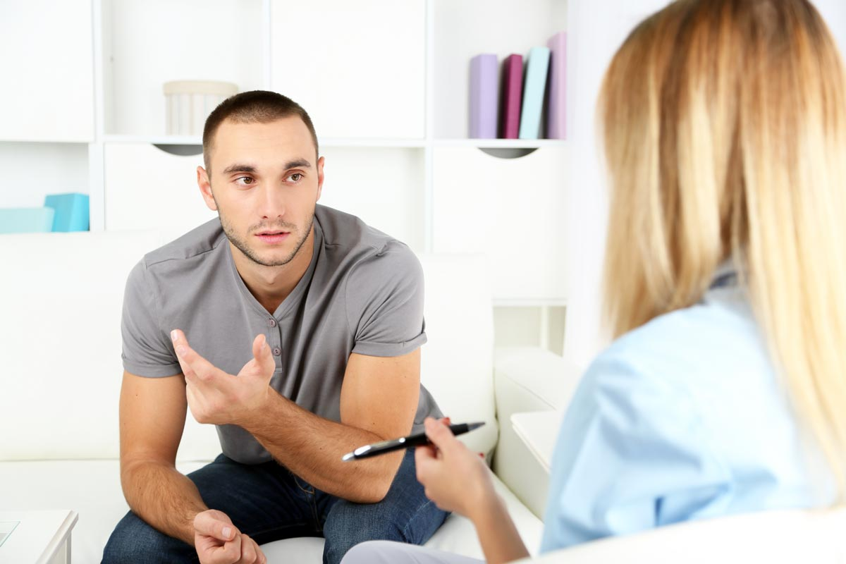 goodencenter-the-connection-between-mental-illness-and-substance-abuse-photo-of-a-Young-man-on-reception-at-psychologist