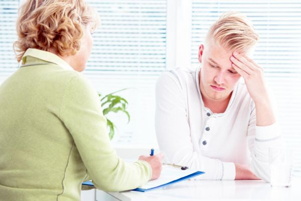 goodencenter-the-connection-between-mental-illness-and-substance-abuse-photo-of-a-doctor-talking-to-her-male-patient-at-office