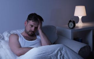 goodencenter-Sleep-and-Mental-Health-photo-of-a-man-suffering-from-sleeplessness