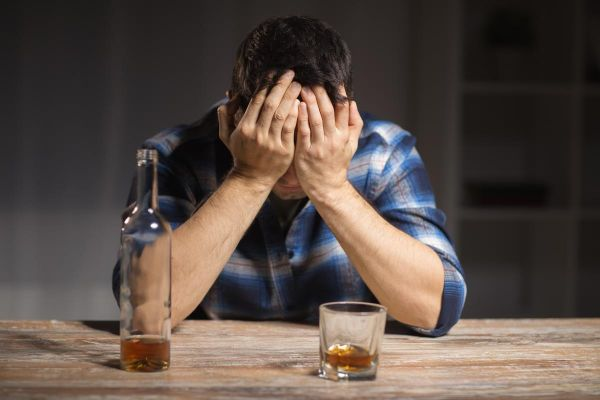 goodencenter-Why-Alcohol-and-Antidepressants-Should-Not-be-Mixed-photo-of-male-alcoholic-with-bottle-and-glass-drinking-whiskey-at-night