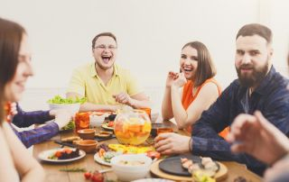 goodencenter-Nutrition-and-Mental-Health-photo-of-Young-people-having-fun-at-dinner-with-friends