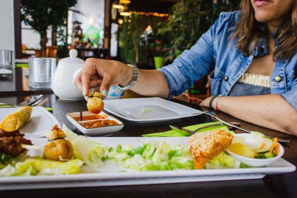 goodencenter-Nutrition-and-Mental-Health-photo-of-a-woman-eating-healthy-foods