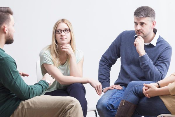 goodencenter-mens-issues-in-substance-abuse-treatment-photo-of-Young-people-talking-in-support-group-about-problems