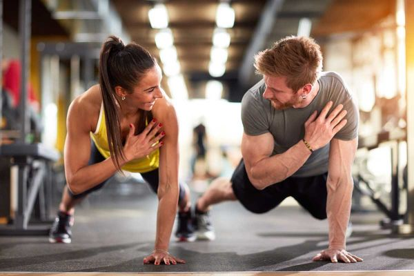 goodencenter-ten-Ways-to-Track-Your-Mental-Health-photo-of-Man-and-woman-strengthen-hands-at-fitness-training