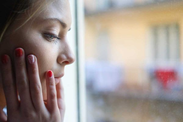 goodencenter-ten-Ways-to-Track-Your-Mental-Health-photo-of-young-girl-next-to-window-glass