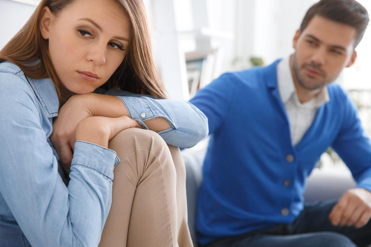 goodencenter-How-to-Help-Someone-Who-Is-in-Denial-of-Their-Mental-Illness-photo-of-young-couple-waiting-for-psychology-session-family-problems