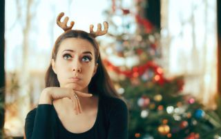 goodencenter-How-to-Maintain-Your-Mental-Health-over-the-Holidays-photo-of-a-sad-and-bored-beautiful-woman-on-christmas-day