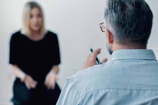 goodencenter PTSD and Addiction photo of a female patient with psychologist during therapy drug addiction concept