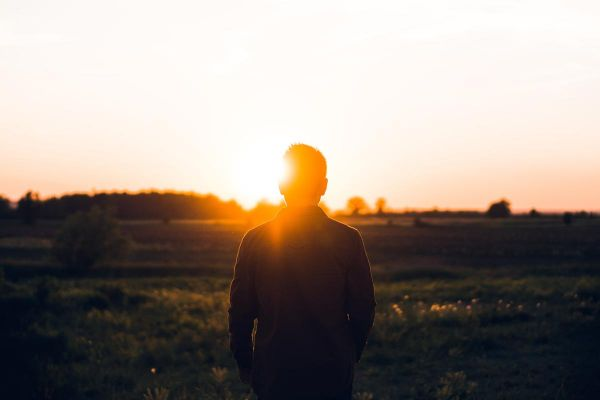 goodencenter-Using-the-Saint-Francis-Assisi-Prayer-in-Recovery-photo-of-man-standing-facing-sunset