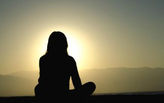 goodcenter Can Mindfulness Help Me Recover from Opioid Addictio photo of a woman meditating near the ocean