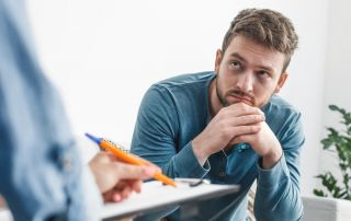 goodencenter Tips for Talking About Your Mental Health photo of Man with a psychologist during consultation