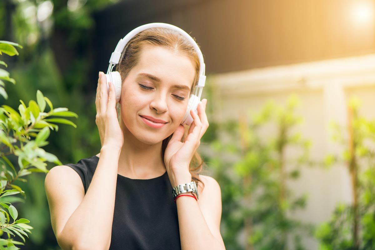beautiful woman listening to music using it as a therapy for mental health