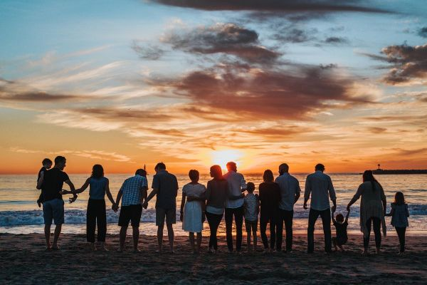 photo of family on the beach during sunset Rebuild Ties Early in Sobriety